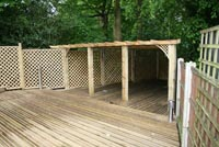 Large decking and roofed pergola